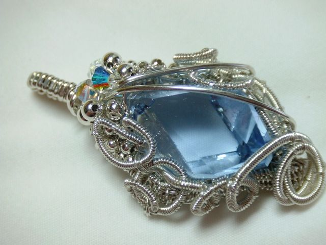 Swarovski Cubist crystal wrapped in sterling silver wire.