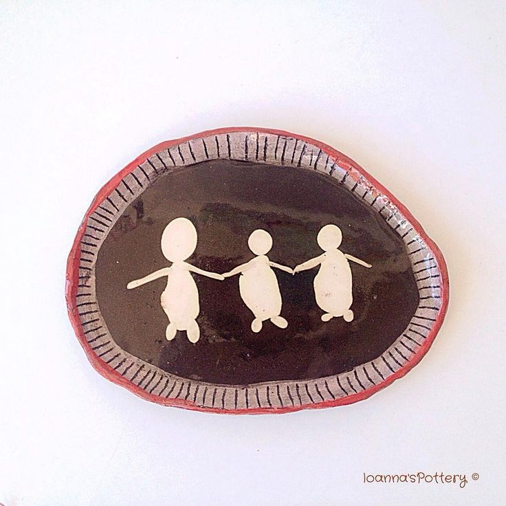 """""""The dance"""" , a game of clays. Serving plate made from two different clays, black & white, coloured slip and clear glaze."""