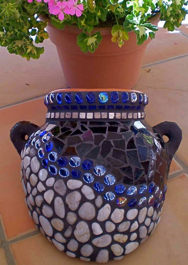 Mosaic terracotta pot with river rock, stained glass, travertine tiles, and glass gems