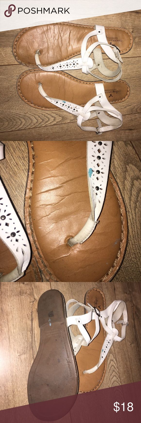 AEO WHITE LEATHER THONG SANDLES Sz10 pre-loved priced accordingly white leather with buckle around ankle price is firm these are my daughters so I cannot trade nor can I reduce price also as seen in photo there is a small blue mark on one of the sandals it looks like paint just needs white shoe polish over American Eagle Outfitters Shoes Sandals