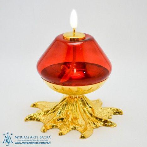Lampada per cera liquida in vetro bianco con base in raffinata ed elegante fusione in bronzo dorato. Sono possibili anche varianti con base argentate e vetri rossi.  Misure: Altezza 16 cm Base 20 cm