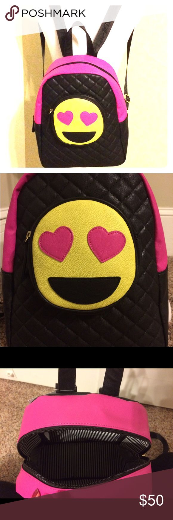 """⚡️FLASH SALE⚡️NWT Betsey Johnson emoji backpack NWT Betsey Johnson heart eyesemoji backpack. Black on the front & back & hot pink on the sides. White & black stripes on the inside w/ """"Luv Betsey by Betsey Johnson"""" written in hot pink. Large heart eye emoji on the front that is also a zip closure pocket & diamond stitch detail throughout the entire backpack. Straps say """"Luv Betsey"""", & has gold emblem on the side. Inside features 1 lg zip pocket, 3 pen slots & 1 cell slot. Approximate…"""
