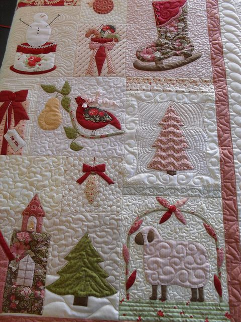"""Christmas"". The machine quilting is masterful."