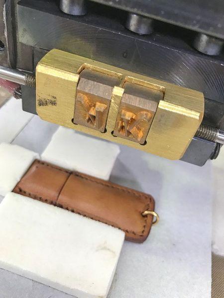 Hot printed leather pen-drive with initials - Panama Trimmings at DENIM PREMIERE VISION Paris | 02-03 November 2016