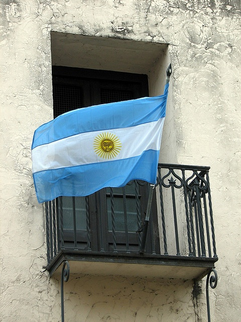 Argentina Flag. The light blue represents many elements of vigilance, truth and loyalty, perseverance & justice. The white represents peace and honesty. The sun represents the Sun of May.