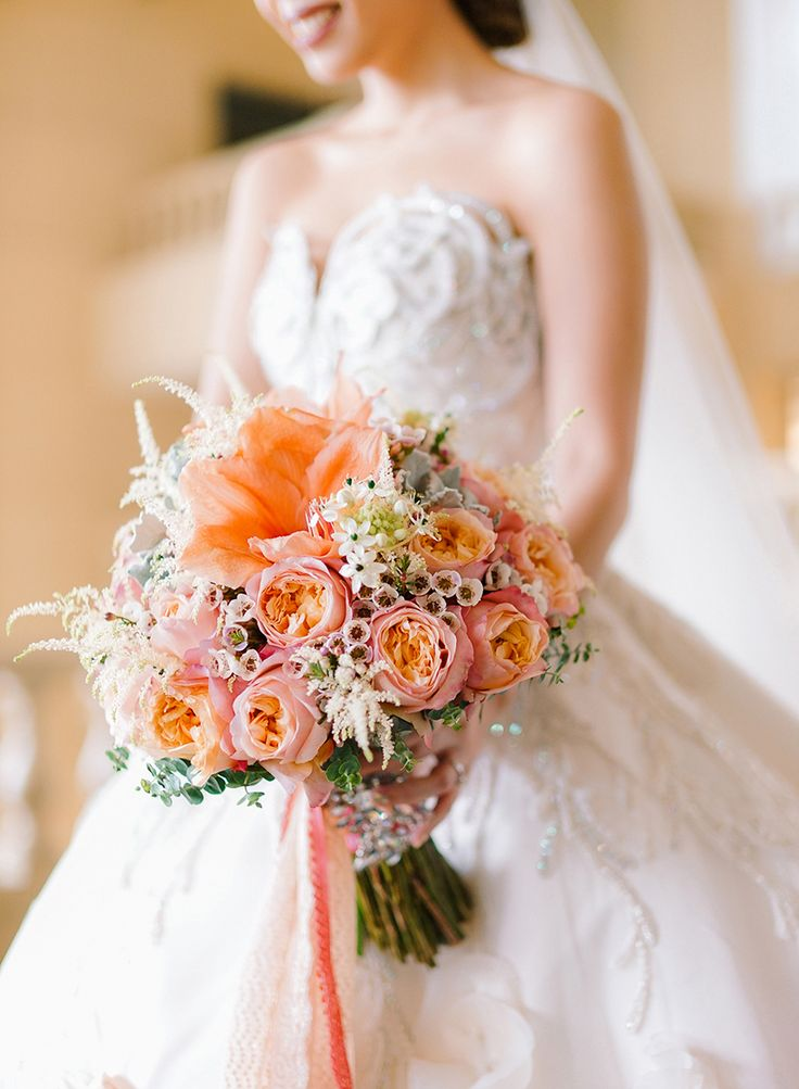 Wedding bouquet of pink, coral and blush flowers {Facebook and Instagram: The Wedding Scoop}