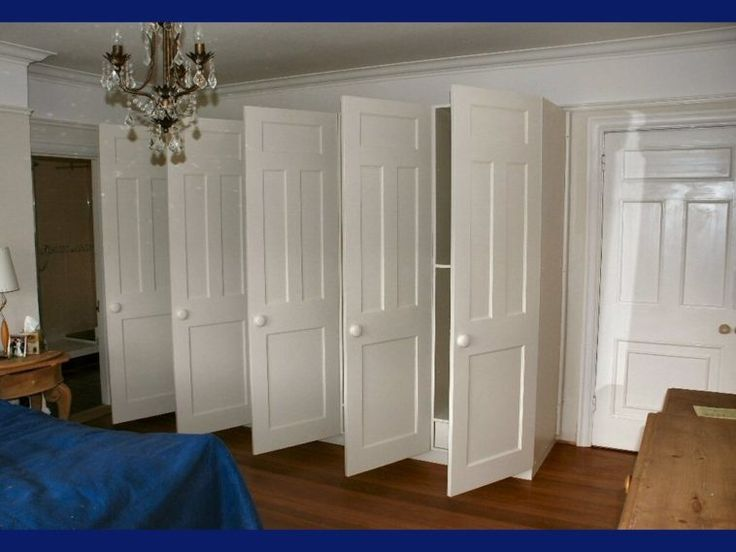 white wooden wardrobe closet with five rectangle doors and white knob on  laminate flooring. Best 25  Wooden wardrobe closet ideas on Pinterest   Doll