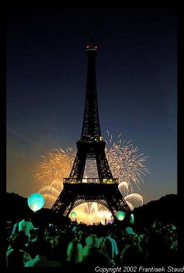 Fireworks behind the Eiffel Tower during Bastille Day celebrations, Paris