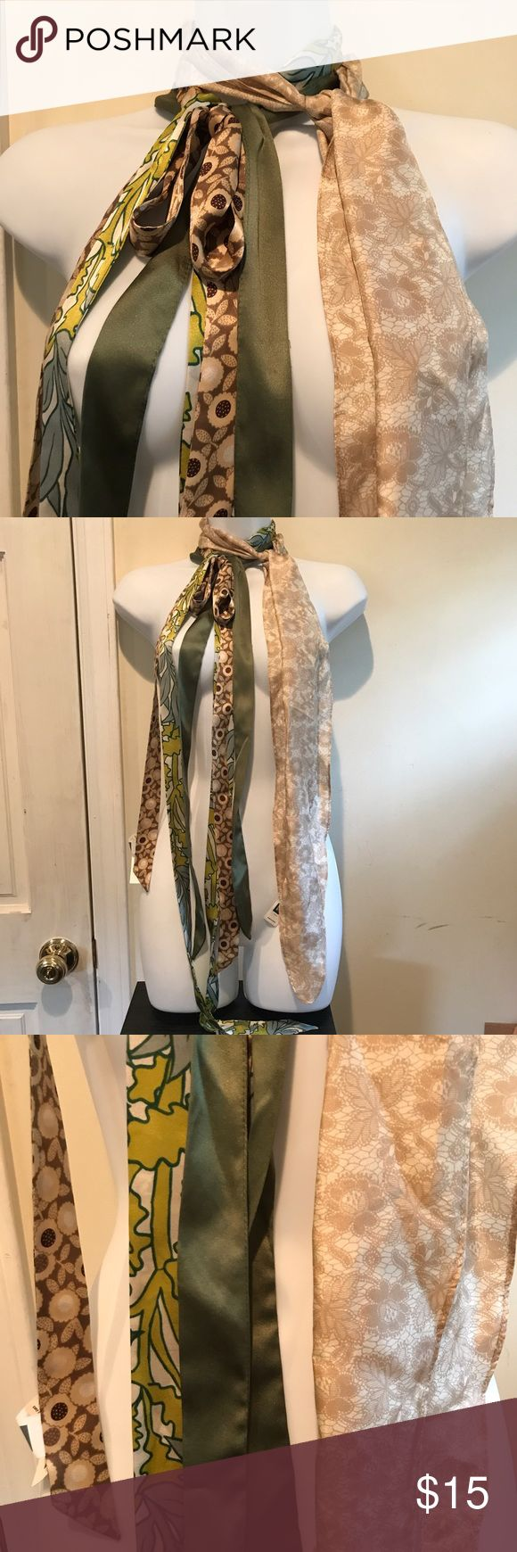 """Lot of 4 GAP silk ties belts hair accessories Lot of 4 silk ties from the Gap. Could be worn as a belt, around neck, or in hair. Tan lace is 66"""" long x 5"""" wide. Brown flowers is 83"""" l x 1 1/4"""" w and has price tag on it still. Green pattern is 82"""" l x 1 1/4"""" w. Solid green is 64"""" l x 1 1/4"""" l and is the only one without a tag. All came from an outlet store and have never been worn. GAP Accessories"""