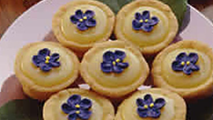 These dainty little tarts are perfect for a bridal shower or wedding reception.  Candy violets or small candy flowers can be used as a garnish.  They can be purchased at specialty housewares stores, craft stores, bakeries or from cake decorating mail order catalogs.