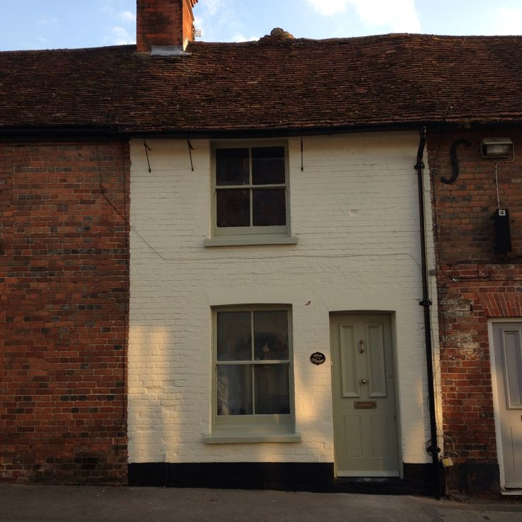 The house has been painted!! Farrow and ball lime white and French gray