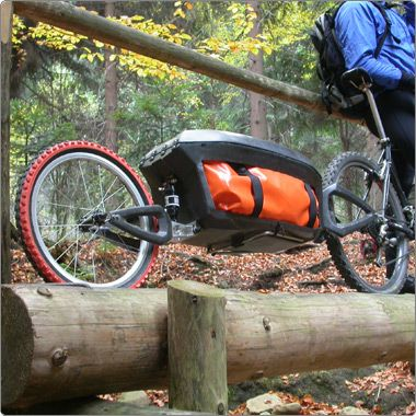 Single tire trailers are the BEST when you're trying not to stick out into traffic!  Two tire trailers are great for weight I suppose, but single tires have a less wide profile and will make your life much more pleasant.  bike-tent-trailer