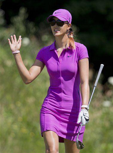 July 9, 2012    Michelle Wie in Purple Dress Wins Attention but Loses Trophy.