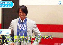 Noriaki Kasai borrowing his gold medal