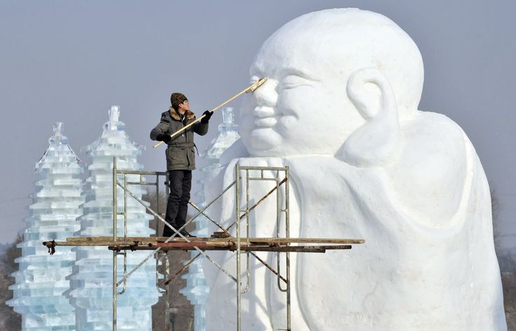 uulus@hotmail.comA man polishes a snow sculpture in preparation for Shenyang International Ice and Snow Festival, Liaoning province, China. The festival kicks off on January 10. (Reuters)