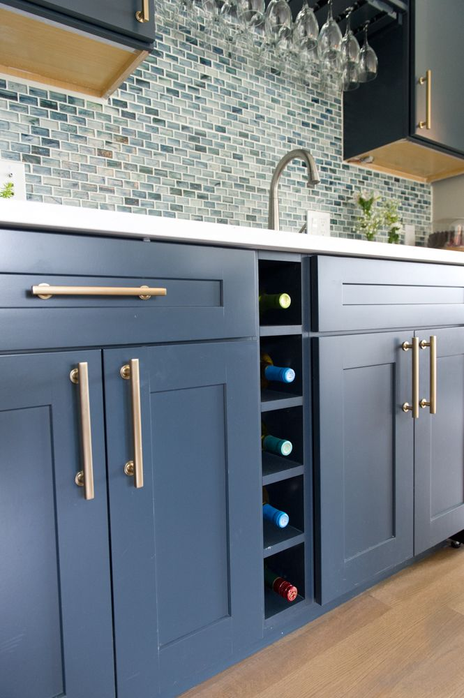 Freestone pulls in Satin Brass by Emtek accent the Maritime Blue wine bar station by Diamond Cabinets.