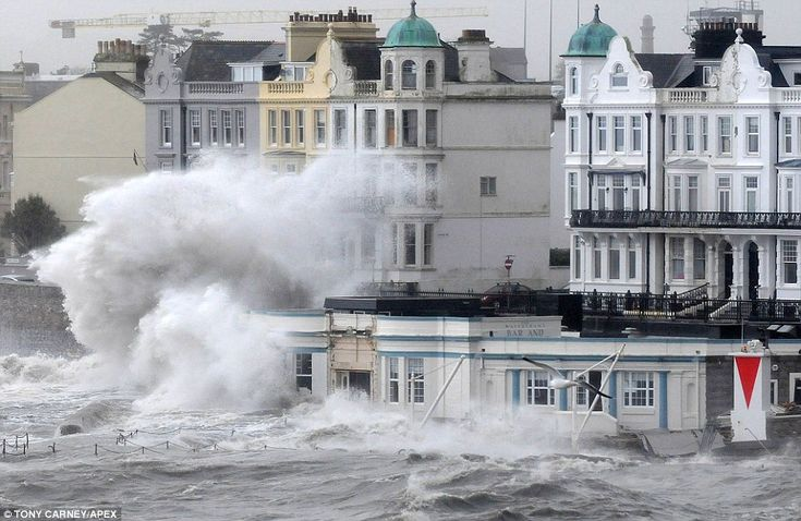 Rising water: A waterside bar is pounded by the waves in Plymouth as the south-west bears the brunt of the Atlantic storm that first hit ove...