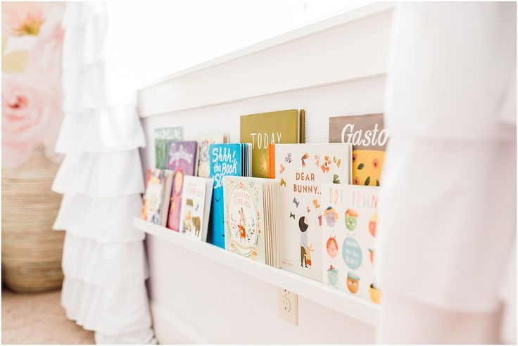 Display your childs books and put them at their level for easy reading access.  Little girl room tour, girls room decor, girls nursery, nursery decor, big girl room by Hello Baby Brown.