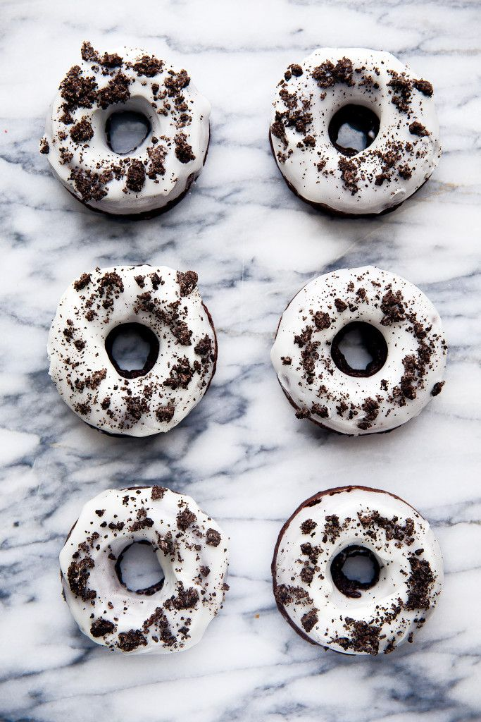 Chocolate donuts with crushed Oreo cookies topped with a vanilla glaze