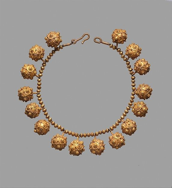 11 c.. Iran. Gold; granulation Dimensions:H. 16 in. (40.6 cm) W. Lg. bead 7/8 in. (2.2 cm) D. Lg. bead 1 in. (2.5 cm) Wt. 5.1 oz. (144.6 g). Accession Number:1972.218.1  Both men and women wore silver and gold necklaces in Seljuq times, but these resemble women's chokers. The spherical gold beads of this necklace would have been formed by hammering gold sheet into a stone with a hemispherical depression and soldering the two halves together.