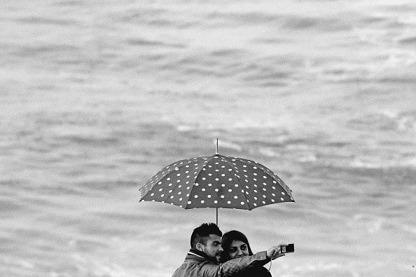 This image has been processed with digital filters A couple takes a «selfie«while waves caused by an Atlantic storm hit the coast of Portugal on...