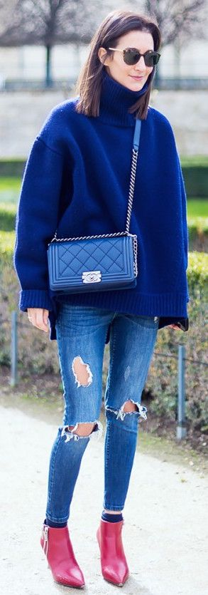 Royal blue turtleneck sweater paired with ripped, cropped skinny jeans and red pointed toe ankle boots
