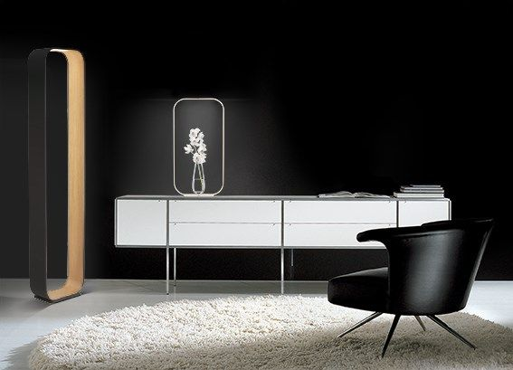Contour floor and table lamps by Pablo There's a USB port on the light to charge your phone!