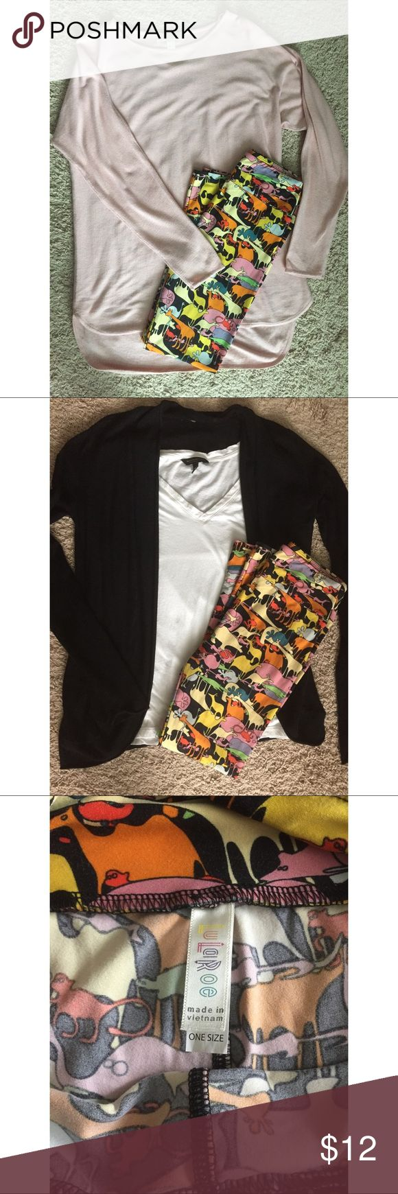 Lularoe OS Leggings (Zoo Animals) Good condition. Worn/washed a handful of times, minor piling in between leg area but not bad. Very colorful w/several different zoo animals, my fave is the gator! I'm only selling cause I have too many leggings. Smoke/Pet free home. Price is firm 🦁🐯🐒🐊 LuLaRoe Pants Leggings