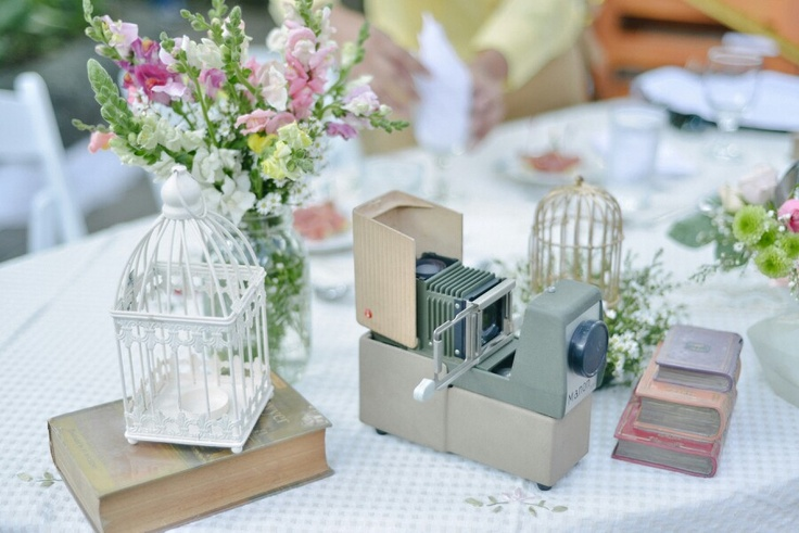 Old books and old camera as table decor. Photo by Nez Cruz