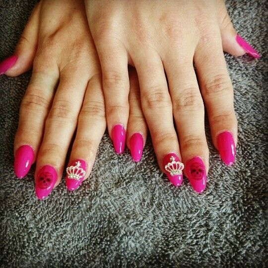 Pink nails with skulls and crowns