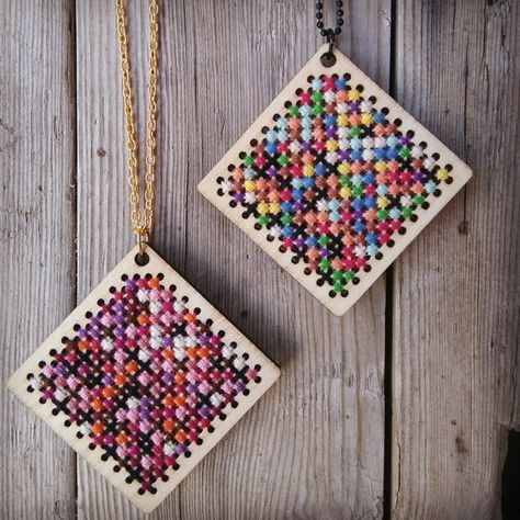 A colorful portrait of Pi's first 228 digits. Handmade mathematical embroidery pendant made of cross stitches on wood. Each color represents a number between 0 and 9. Made by Søstrene Miljeteig.