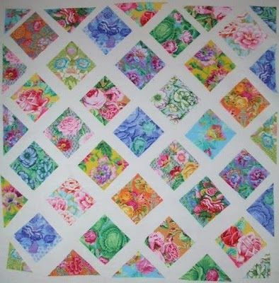 Kaffe - this is on a design wall but I would love it with white sashing --- really sets off the pastel colors.