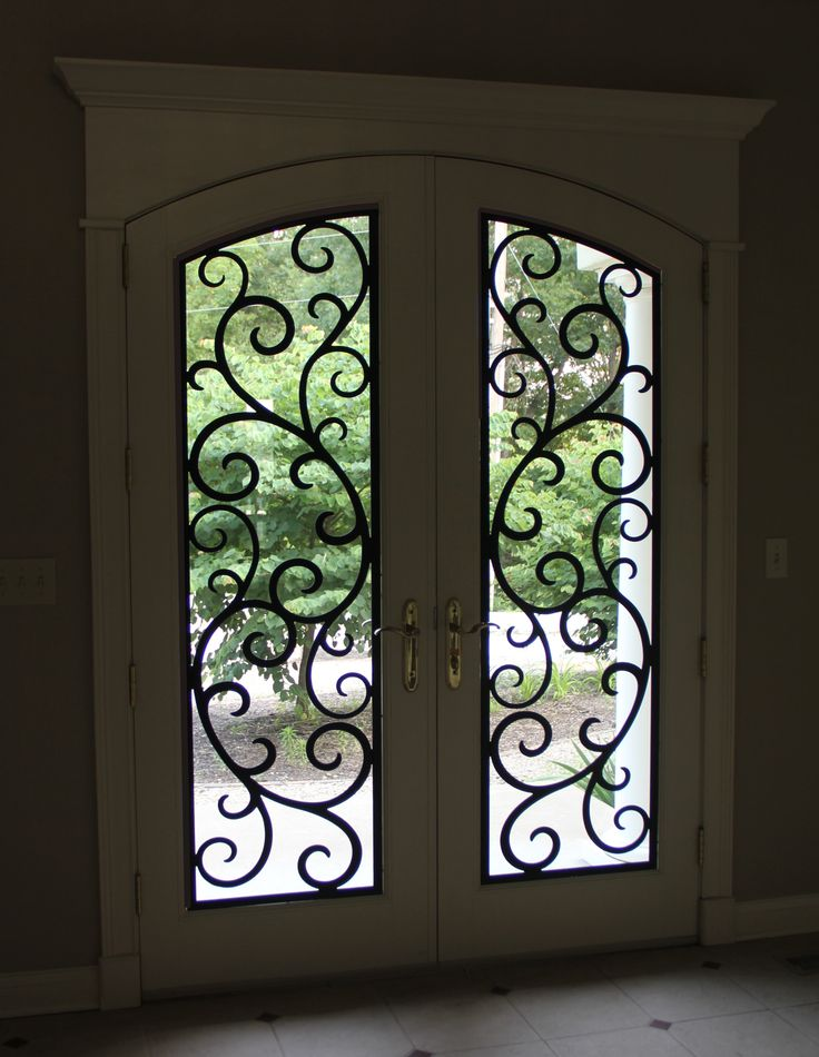 Beautiful front door with faux wrought iron door insert for Door design of iron