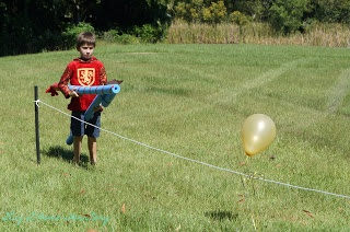 "A Fourth Birthday Knight Party. Loving the balloon idea. Maybe have pool noodles around the stakes, then tie the strings around, so each ""team"" knows where to start?"