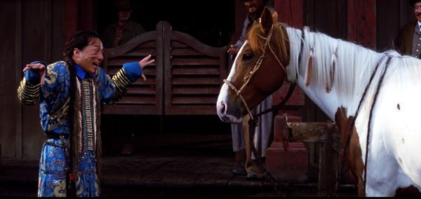 Jackie Chan faces a horse in the movie Shanghai Noon.