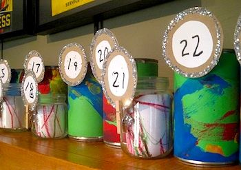 Green advent calendar - Get the kids to help make it. Fill with small candy, small toy or ornament, and a Christmas activity for the family.