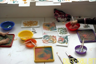Coloured sand art - colour sand with food colouring.  Make patterns in sand, draw a pattern with glue on paper and take a print of the sand.