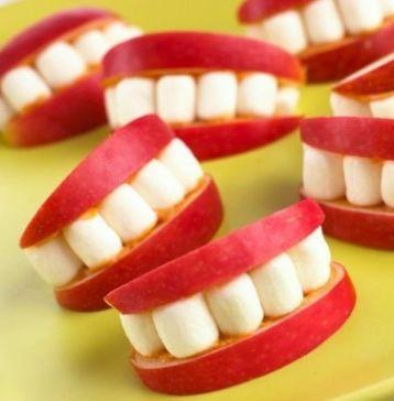 Great Halloween Idea.  Sliced apples, peanut butter and marshmallows