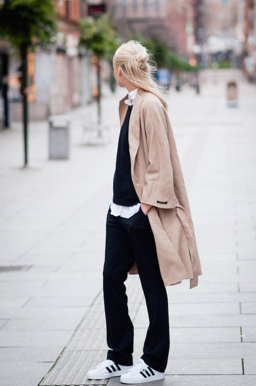 A half-up top knot trench coat, slouchy black pants and Adidas sneakers #style fashion #streestyle #bun