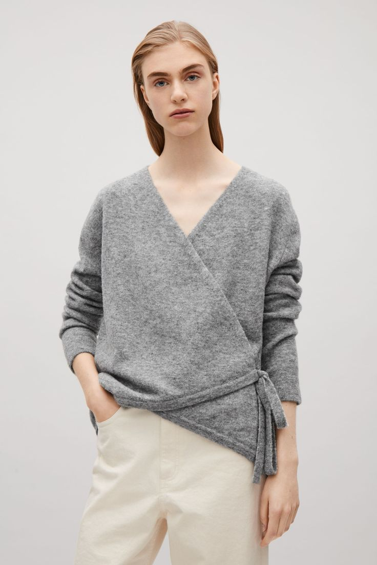 This cardigan is made from a alpaca and wool mix with a soft-brushed,  melange finish. A wrap-over style that ties at the side, that can be worn  both open ...