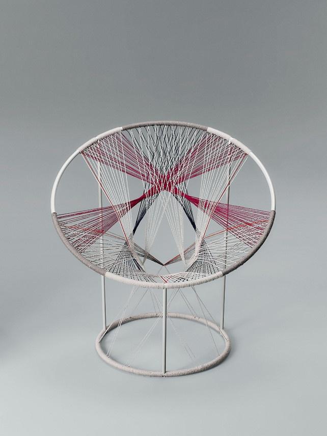 Brooklyn-based Todd Bracher created eye-popping string art by lacing Kvadrat Hallingdal 65 fabric around a hoop chair