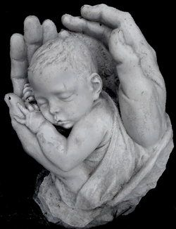 Not a stone, but a beautiful sculpture I photographed at the grave of a 2 month old baby boy, near Manhattan, Kansas.