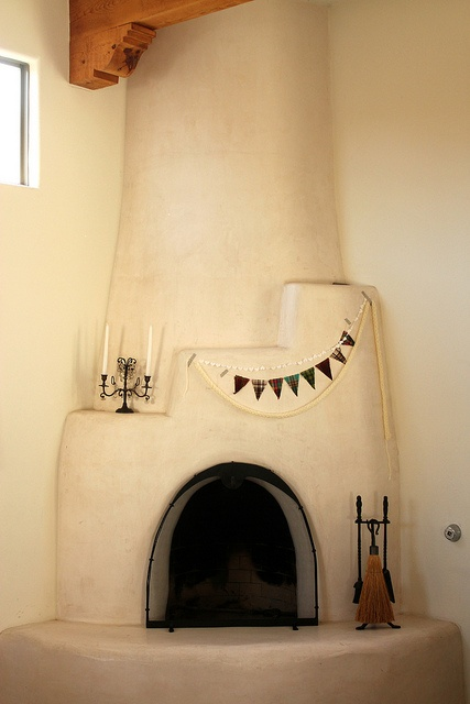 Adobe fireplace/ multiple-strand bunting in the corner