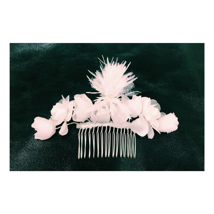 Cecile Millinery, silk flower and ostrich feather . Handmade in London.