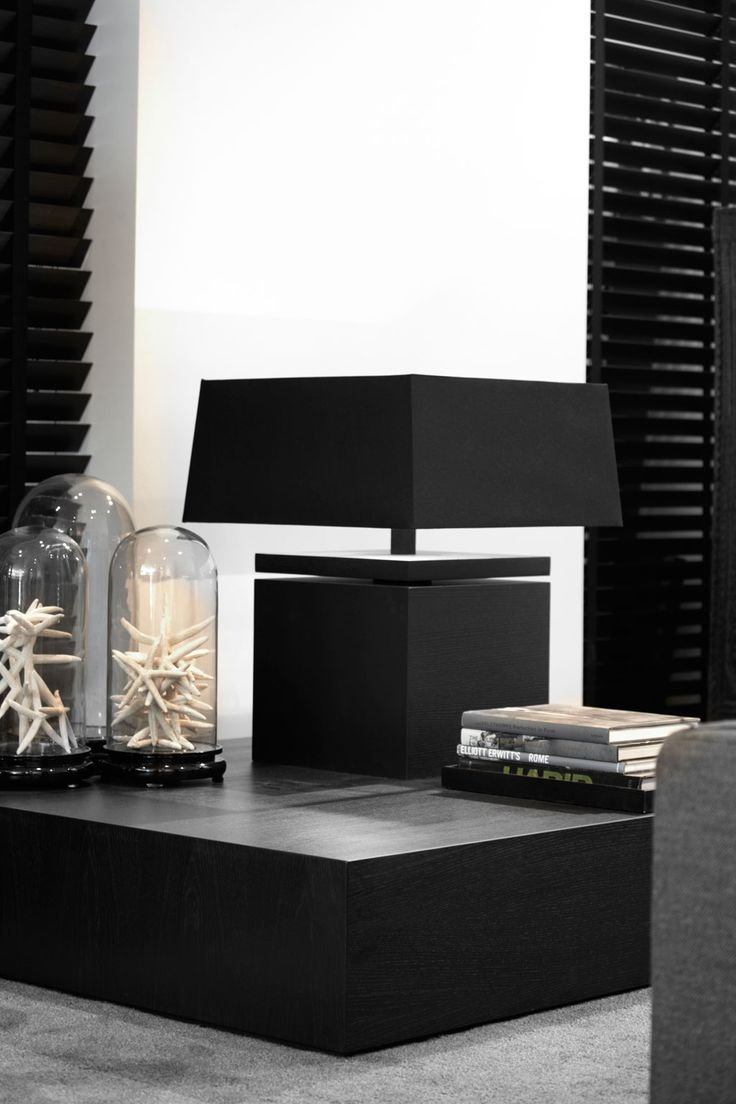 #loft condo with tall, black shutters, square black end table and lamp