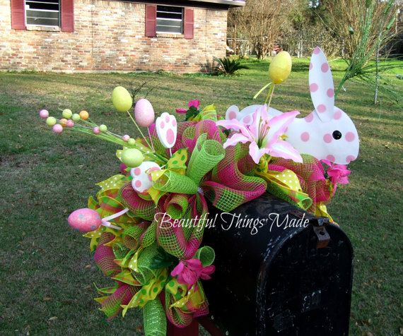 Easter mailbox topper, Mailbox swag, mailbox decoration. This is an adorable mailbox decoration. It is made with Green and pink deco mesh, with matching deco mesh curls. It has a Cute metal bunny holding an Easter egg, and is decorated with easter eggs, silk flowers, and wired ribbons. Dont forget to decorate your mailbox when you decorate your house. To view all of my wreaths please follow this link: https://www.etsy.com/shop/Beautifulthingsmade?section_id=1615843...