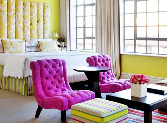 Modern English style...love these fuchsia tufted chairs!