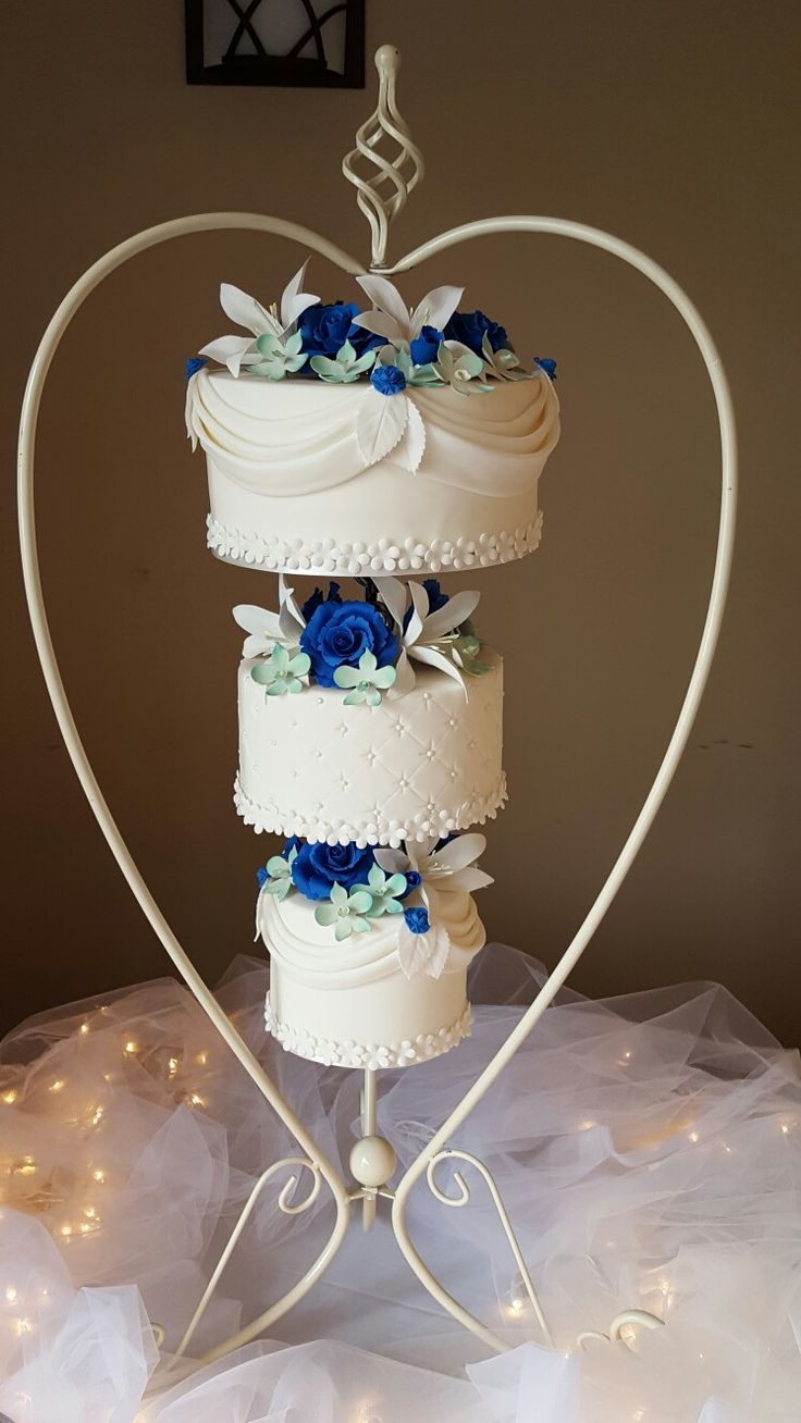 Chandelier Cake with royal blue sugar roses, orchids and lilies