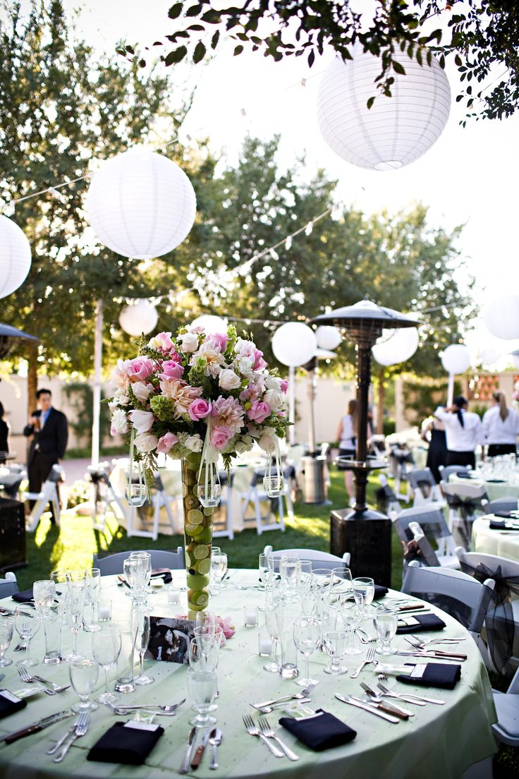 Black folding chairs wedding - White Paper Lanterns Festival Lights Pastel Striped Overlay On A White Table Cloth