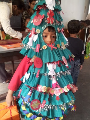 I made my son a little christmas tree for his school fancy dress competition. The costume is made totally of paper. He won the first prize #DIY